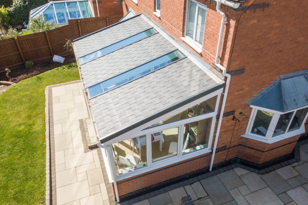 Long solid roof lean to conservatory