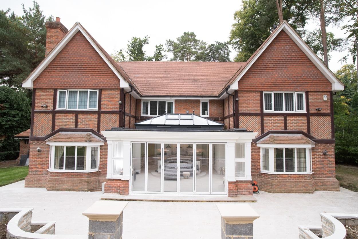 Modern orangery built on traditional home