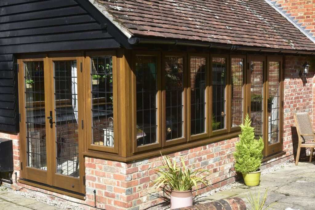 wooden effect windows with lead bars